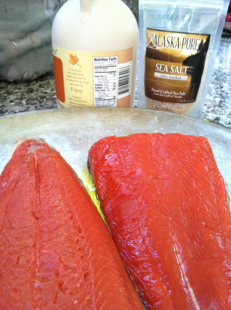 """Kathy Gunst prepares her recipe of """"Grilled Salmon with Maple Glaze and Sea Salt."""" (Kathy Gunst/Here & Now)"""