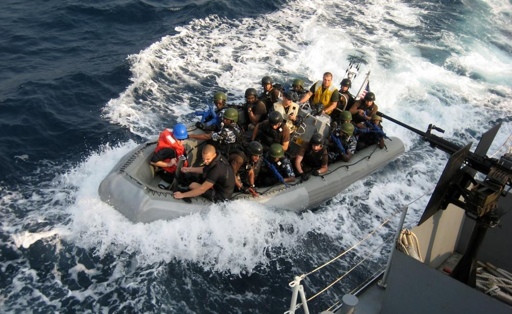 A crew of U.S. sailors and Nigerian special forces fighters engages in training exercise off the Nigerian coast in 2010. The U.S. Navy offered training to the Nigerian navy as worries mount of increasingly violent pirate attacks along the West African coast. (Jon Gambrell/AP)