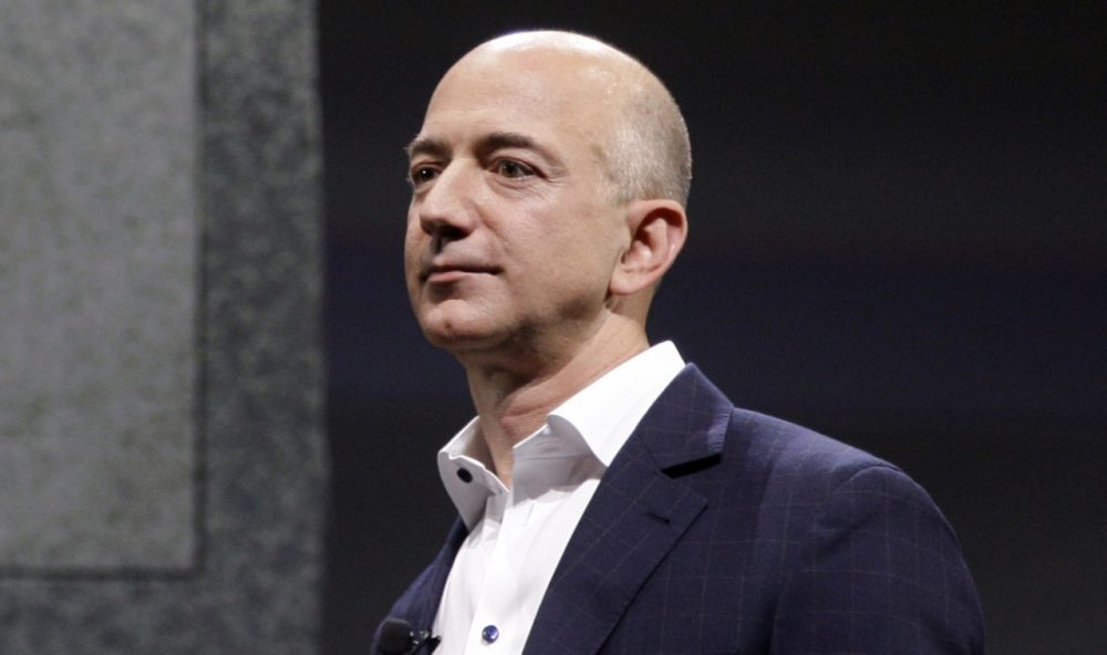 Jeff Bezos, CEO and founder of Amazon, who recently bought the Washington Post, maybe part of a trend of entrepreneurs following the slow money business model. (Reed Saxon/AP)