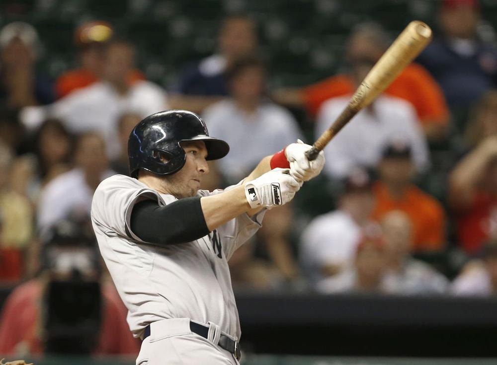 Boston Red Sox's Stephen Drew hits a three-run homer to go ahead of the Houston Astros in the ninth inning. (Pat Sullivan/AP)