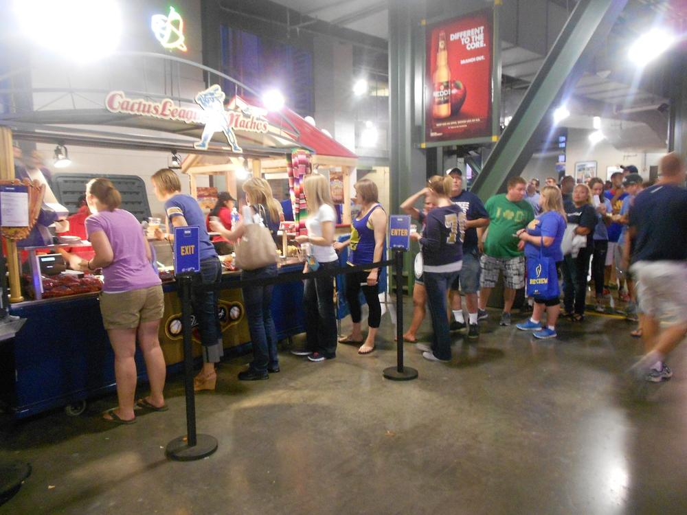 The scene at a Miller Park concession stand as fans wait to use their $10 vouchers. (LaToya Dennis/Only A Game)