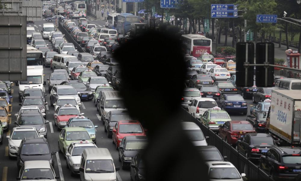 A street becomes clogged with traffic in Shanghai, China, Wednesday, May 29, 2013. With more than 13 million cars were sold in China last year. (Eugene Hoshiko/AP)