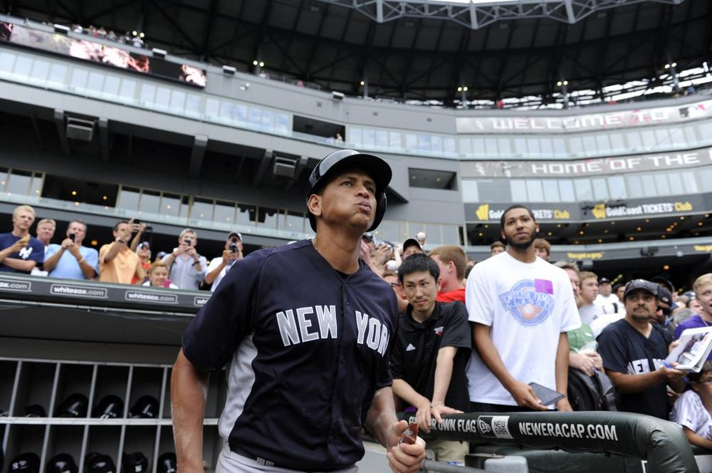 Alex Rodriguez is taking the field for the New York Yankees while the MLB Players Association appeals his 211-game suspension. (David Banks/AP)