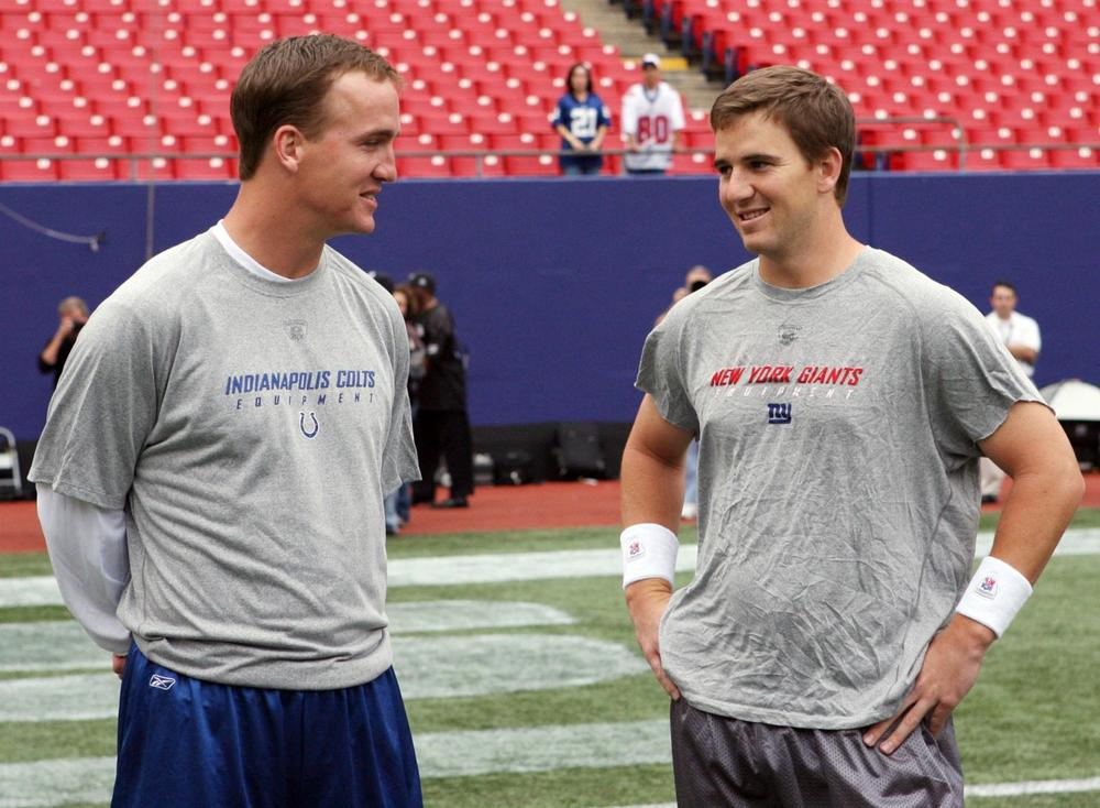 After hearing the duo's rhymes, <em>Only A Game</em> analyst Charlie Pierce thinks NFL quarterbacks Peyton (left) and Eli Manning (shown here in 2006) should stick to their day jobs. (Jerry Pinkus/AP)