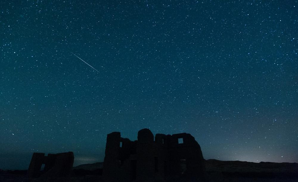 A meteor from the annual Perseid meteor shower falls from space over ruins at Fort Churchill State Historic Park on Sunday, Aug. 12, 2012, in Silver Springs, Nev. (Kevin Clifford/AP)