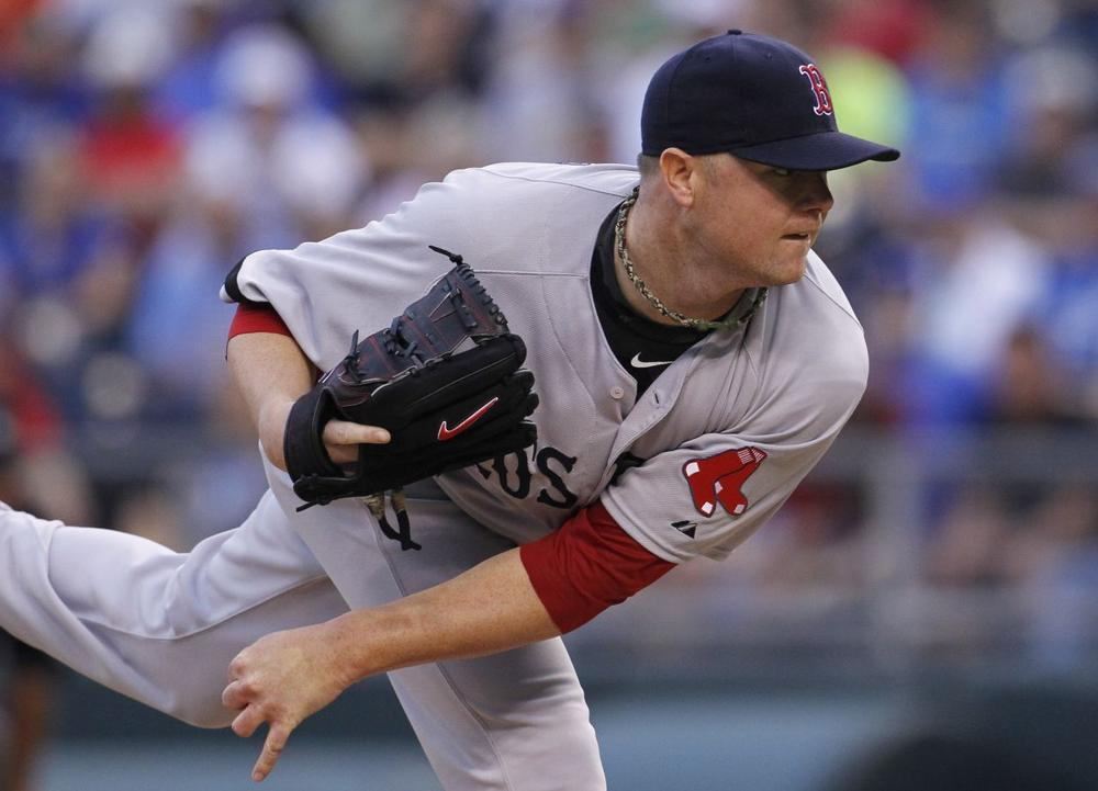 Boston Red Sox pitcher Jon Lester throws against a batter in the first inning of a baseball game against the Kansas City Royals. (AColin E. Braley/AP)