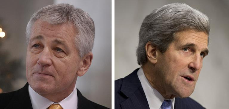 U.S. Defense Secretary Chuck Hagel, left, and U.S. Secretary of State John Kerry, right, meet with their Russian counterparts today in Washington. (AP)