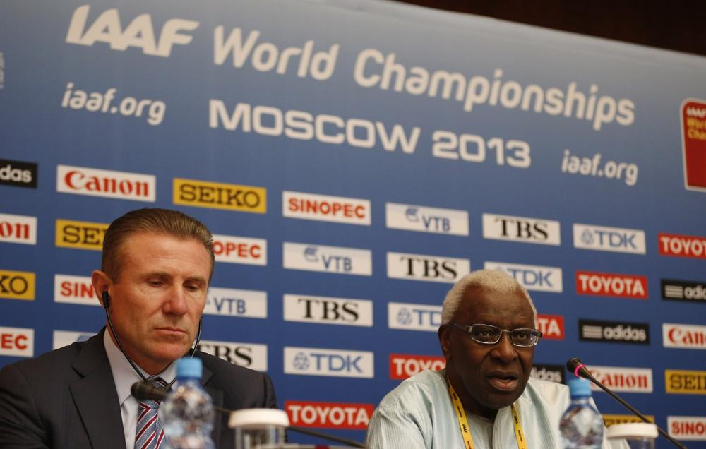 IAAF president Lamine Diack, right, speaks alongside retired athlete and IAAF vice president Sergey Bubka during a news conference at a hotel in Moscow, Thursday, Aug. 8, 2013. (Matt Dunham/AP)