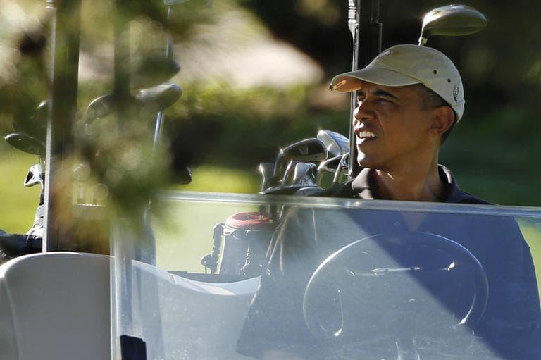 President Barack Obama plays golf at Farm Neck Golf Club in Martha's Vineyard while on vacation in 2011. (Steven Senne/AP)