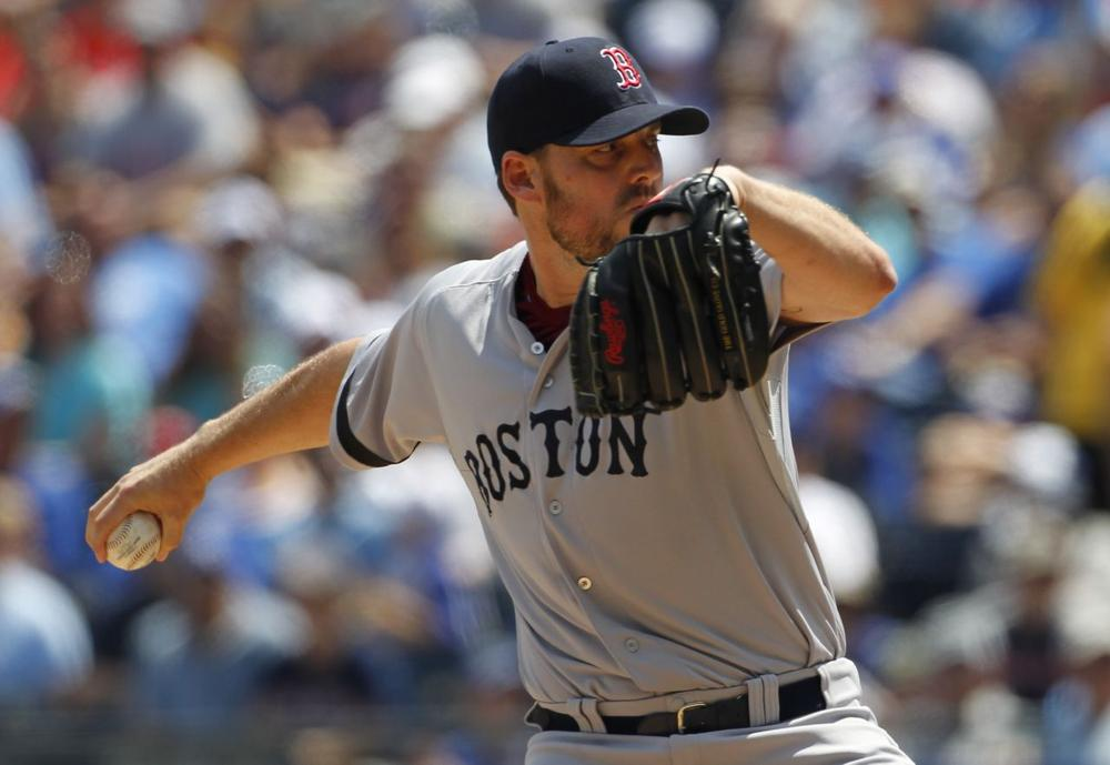 Boston Red Sox pitcher John Lackey throws to a batter in the game against the Kansas City Royals Sunday. (Colin E. Braley/AP)