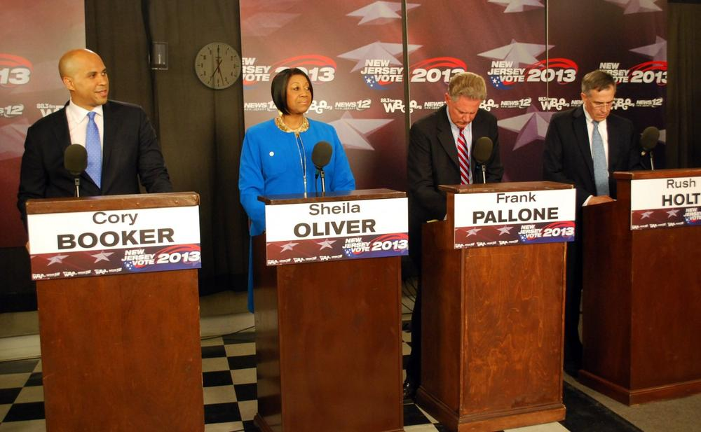 In this photo provided by WBGO, Democratic U.S. Senate candidates, from left, Newark Mayor Cory Booker, State Assembly Speaker Sheila Oliver, U.S. Frank Pallone and U.S. Rep. Rush Holt prepare for a debate Thursday, Aug. 8, 2013, at the WBGO Performance Studio in Newak, N.J. (WBGO via AP)