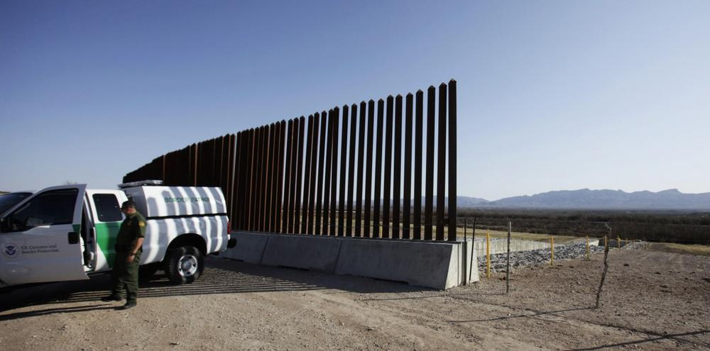 A U.S. Border Patrol sits at the end of the border fence at Fort Hancock in Hudspeth County, Texas, Friday, March 26, 2010. (LM Otero/AP)