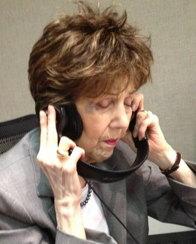"""Scott Simon posted this photo of his mother, Patricia Lyons Simon Newman, with the following caption, """"My mother, enthralled as her son conducts interview at @WBEZ,"""" May 21, 2013. (Twitter)"""