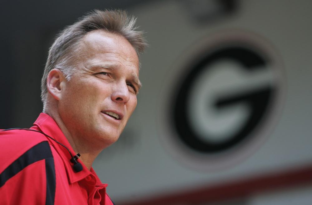 The University of Georgia funds the travel of Mark Richt and other coaches for recruiting visits. (John Amis/AP)