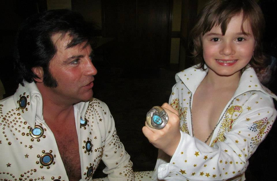 Benjamin Dalske, 7, is pictured in his Elvis attire, along with another tribute artist, Craig Newell. (Facebook)