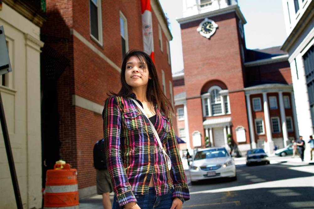 Katherine Asuncion, 20, who came to the U.S. from the Dominican Republic at age 10, was granted deferred action status last December. It has changed her life in substantial ways, she says, but there are caveats. (Jesse Costa/WBUR)