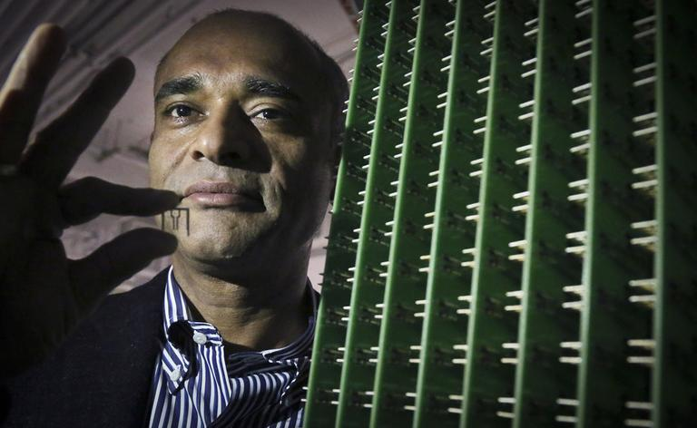 Chet Kanojia, founder and CEO of Aereo, holds one of the company's antennas. When you subscribe to the service, you're basically renting one of these antennas, using the Internet as the cord, and using a cloud server like an online DVR. (Bebeto Matthews/AP)