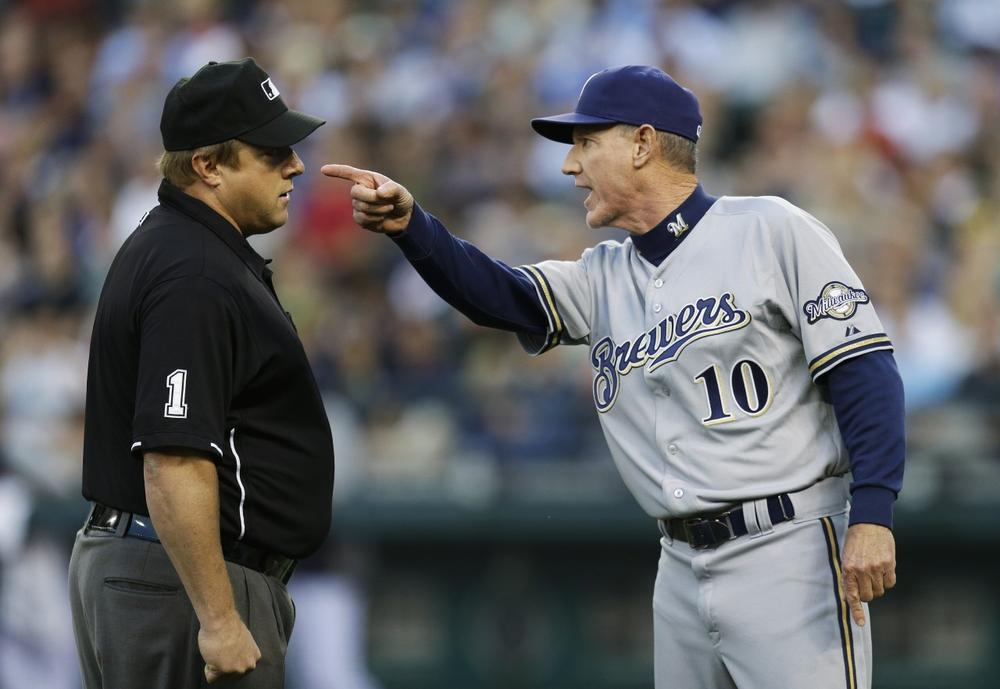 If approved this fall, MLB's plan to use more instant replay review will cut down on disputes — like this one between umpire Bruce Dreckman and Milwaukee manager Ron Roenicke. (Ted Warren/AP)