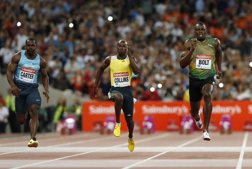Author David Epstein examined Jamaican folklore and scientific research about the island nation's propensity for producing world-class sprinters, including Usain Bolt (right) and Nesta Carter (left). (Sang Tan/AP)