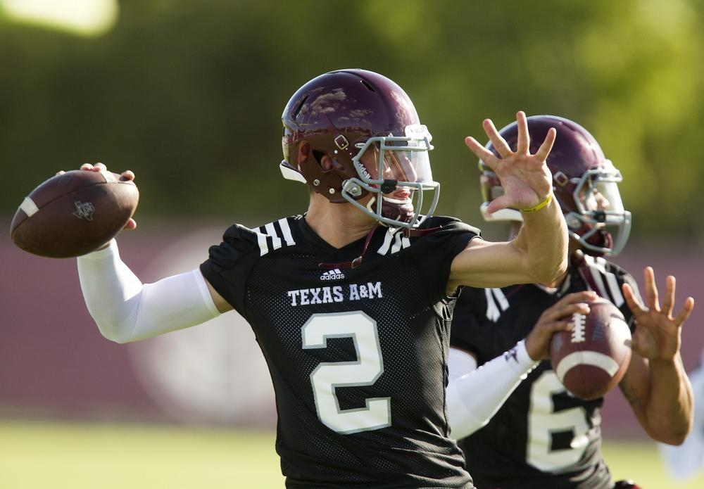 Texas A&M quarterback Johnny Manziel has received much attention in recent weeks — and not because of any passes he has thrown. (Patric Schneider/AP)