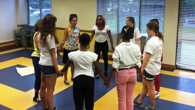 Women participate in the Girls' LEAP self-dense class in Roxbury. (Delores Handy/WBUR)