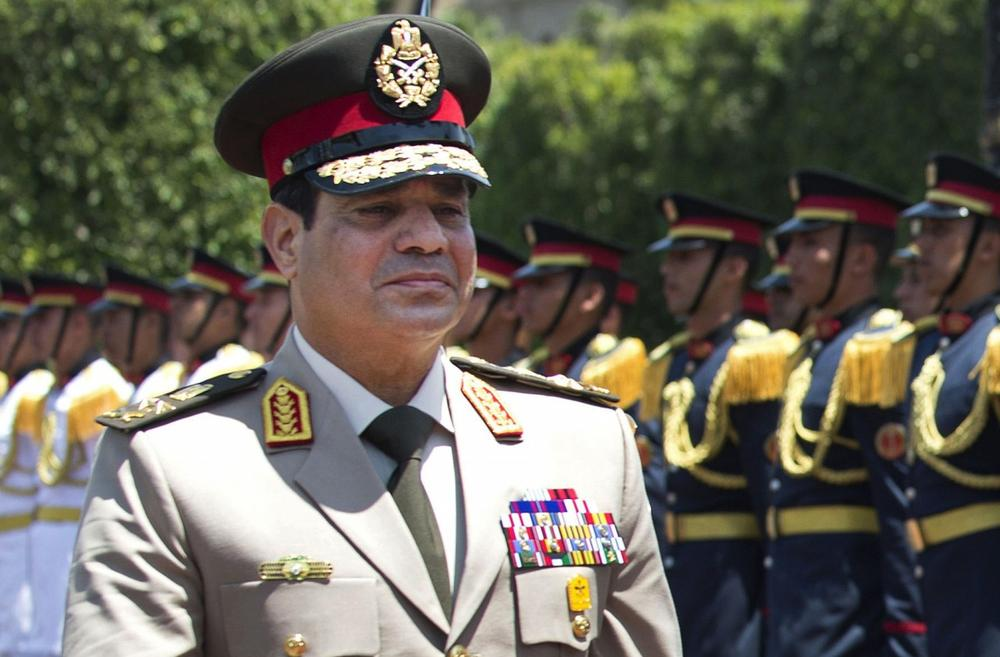 Egyptian Defense Minister Gen. Abdel-Fattah el-Sissi reviews honor guards during an arrival ceremony for his U.S. counterpart at the Ministry of Defense in Cairo, April 24, 2013. (Jim Watson/AP)