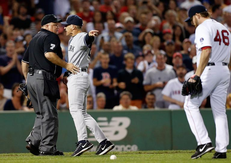 Yankees manager Joe Girardi, center, points at Red Sox pitcher Ryan Dempster while arguing with home plate umpire Brian O'Nora, after Dempster hit Yankees Alex Rodriguez with a pitch. (Michael Dwyer/AP)