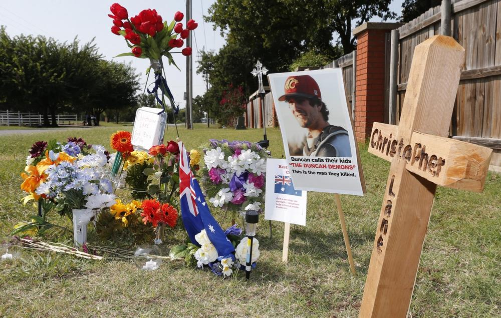 A memorial to Christopher Lane is shown Tuesday, Aug. 20, 2013, along the road where he was shot and killed, in Duncan, Okla. (Sue Ogrocki/AP)