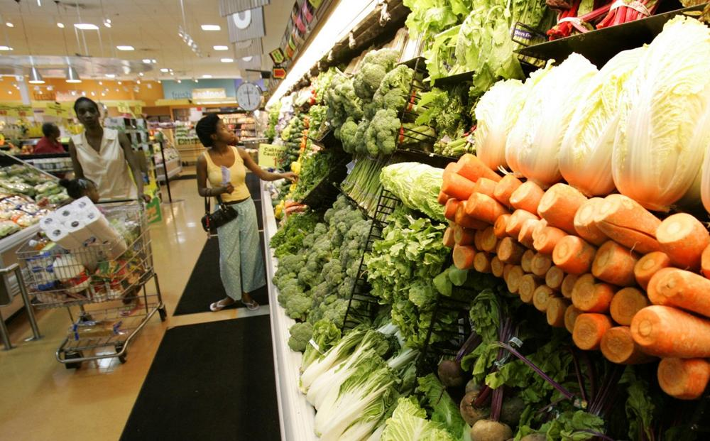 Shoppers peruse the produce section at The Fresh Grocer supermarket in West Philadelphia. (Coke Whitworth/AP)