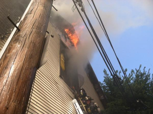 Fire pours out of the roof of the St. John the Baptist Albanian Orthodox Church in South Boston. (Boston Fire Department)