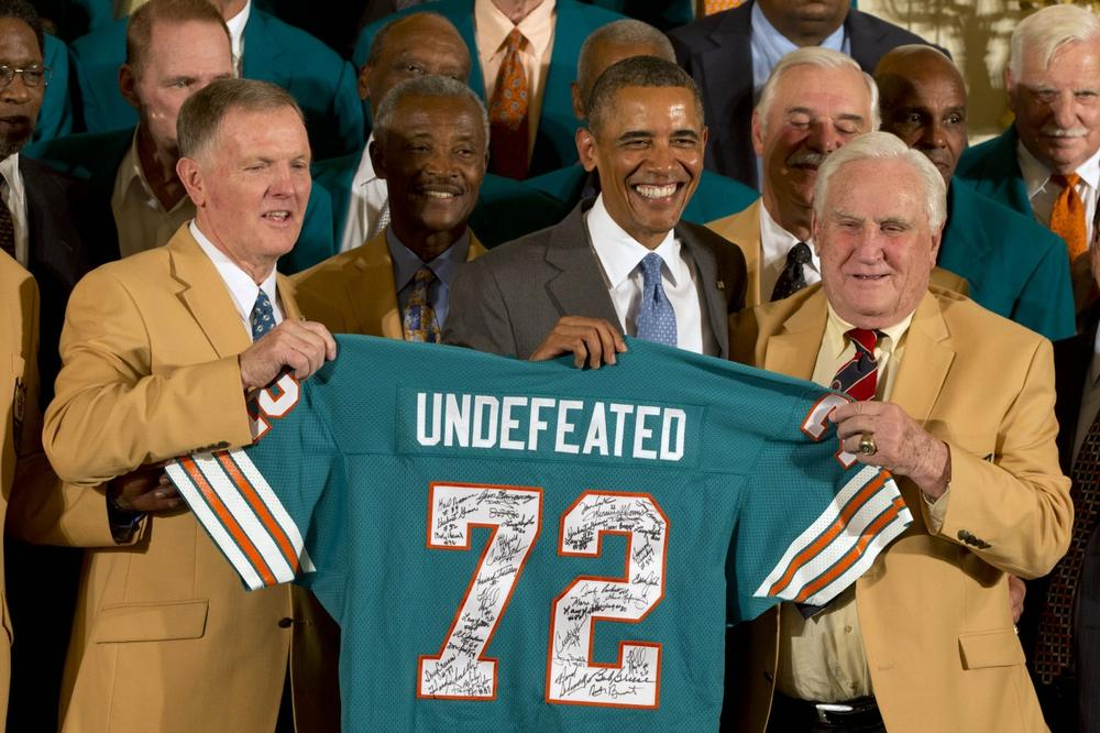 Quarterback Bob Griese (left), coach Don Shula (right) and members of the 1972 Miami Dolphins were honored at the White House on Tuesday. Three players chose to skip the festivities for political reasons. (Jacquelyn Martin/AP)