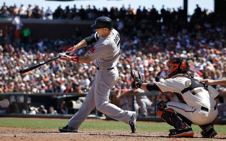 Boston's Stephen Drew hits a three-run home run off San Francisco pitcher Michael Kickham during the seventh inning Wednesday. (Jeff Chiu/AP)