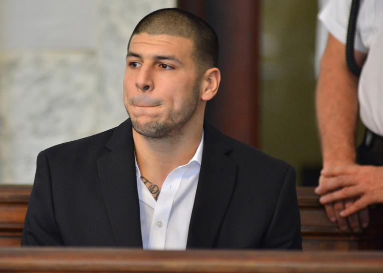 Former New England Patriot Aaron Hernandez, who was indicted on murder charges, listens to proceedings in an Attleboro court Thursday. (Josh Reynold/AP)