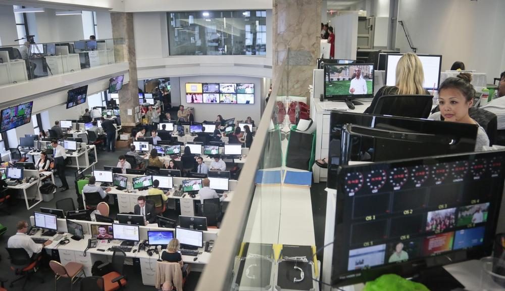 Staffers work in the Al-Jazeera America newsroom after the network's first broadcast on Tuesday, Aug. 20, 2013 in New York. (Bebeto Matthews/AP)