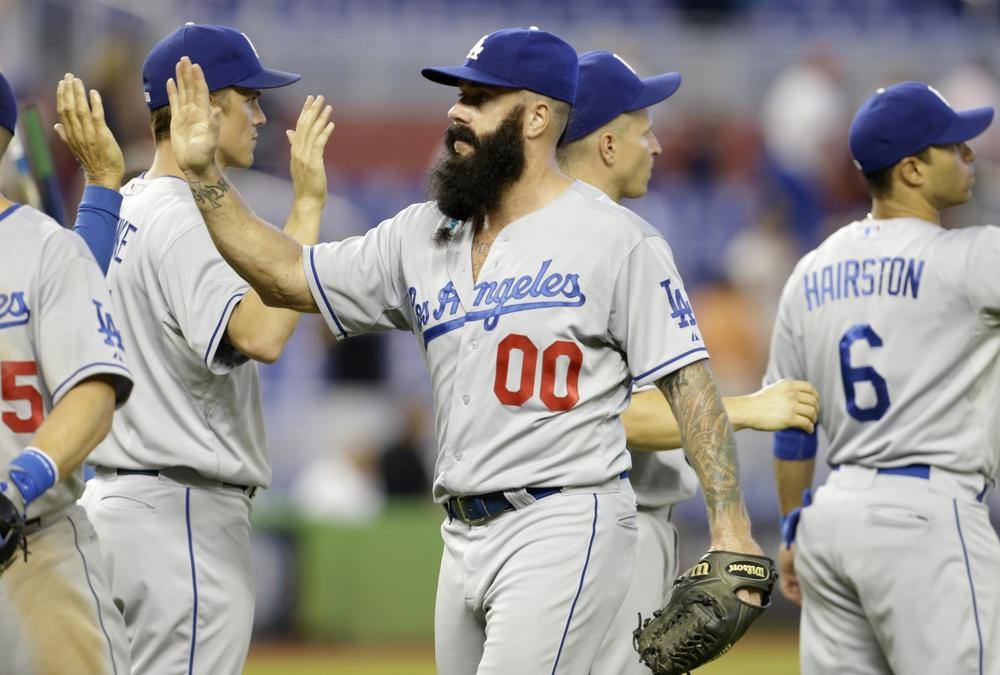 After recovering from Tommy John surgery, Brian Wilson and his beard are back at work, but Wilson could make some extra income by shearing his trademark. (Lynne Sladky/AP)