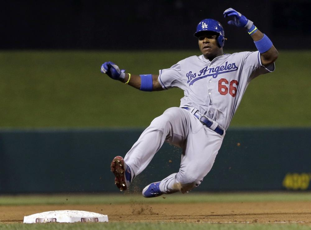 After a blistering start to his MLB career, Los Angeles Dodgers rookie Yasiel Puig has hit some snags. (Jeff Roberson/AP)
