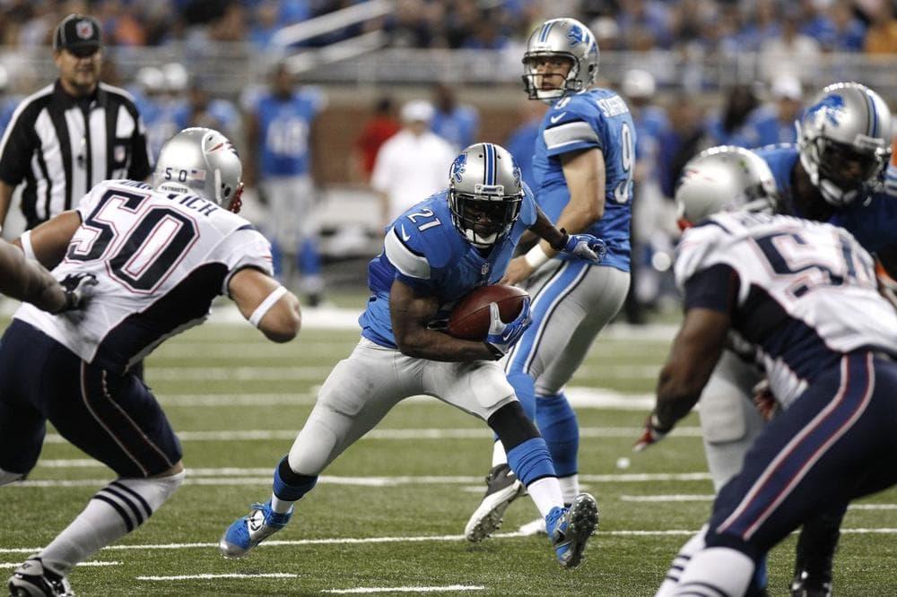 Detroit Lions running back Reggie Bush looks for running room. (Duane Burleson/AP)