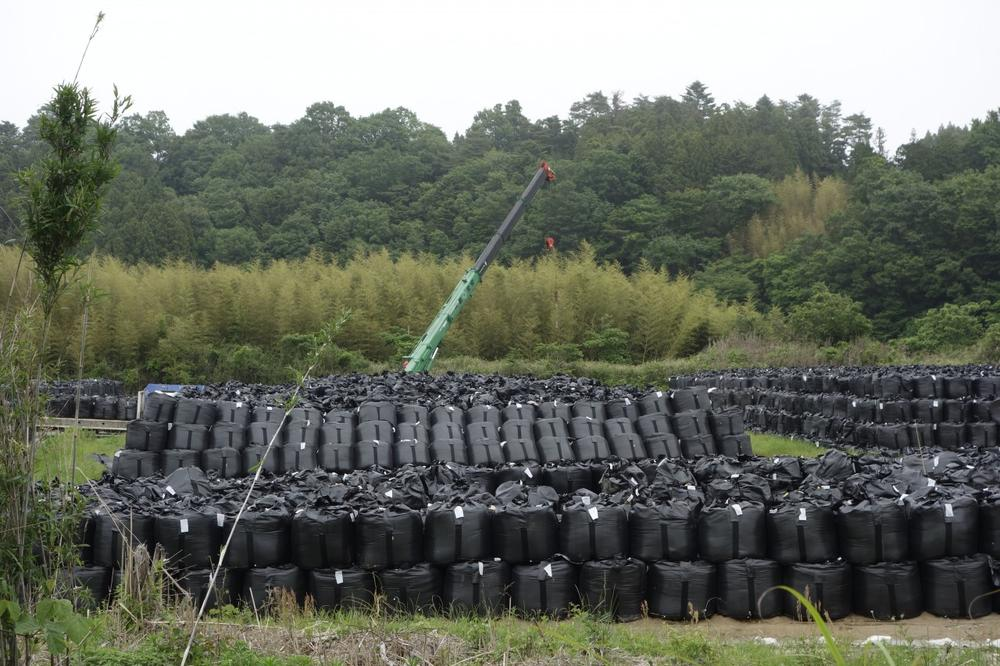 In Fukushima Prefecture, bags of contaminated soil are stacked up in temporary storage sites. (Eliza Strickland/IEEE Spectrum)