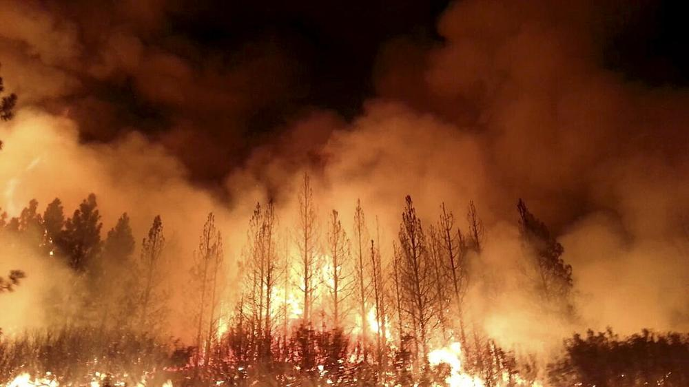In this undated photo provided by the U.S. Forest Service, the Rim Fire burns near Yosemite National Park, Calif. (U.S. Forest Service via AP)