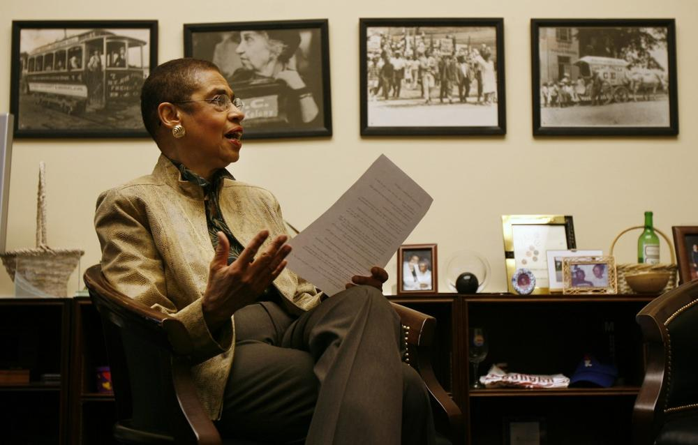 Delegate Eleanor Holmes Norton sits in front of historical photographs of Washington in her office in the House Rayburn building in Washington, Monday, April 9, 2007. (Jacquelyn Martin/AP)