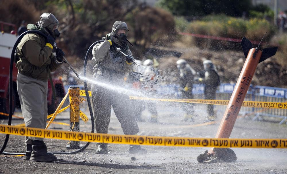 Israeli Defense Forces soldiers take part in a drill that simulates a chemical rocket attack in Jerusalem Wednesday, 29 May, 2013. (Abir Sultan/AP)