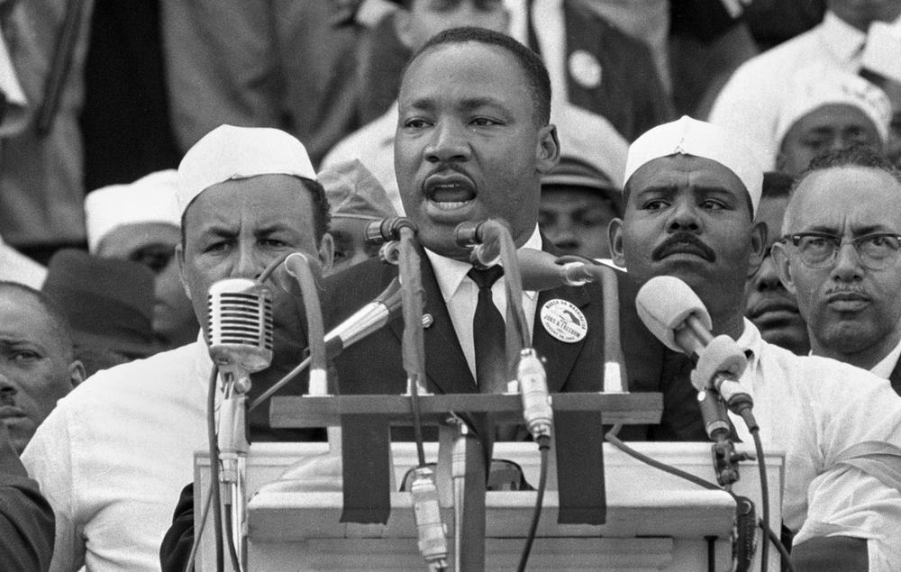 "Dr. Martin Luther King Jr., head of the Southern Christian Leadership Conference, addresses marchers during his ""I Have a Dream"" speech at the Lincoln Memorial in Washington, Aug. 28, 1963. (AP)"