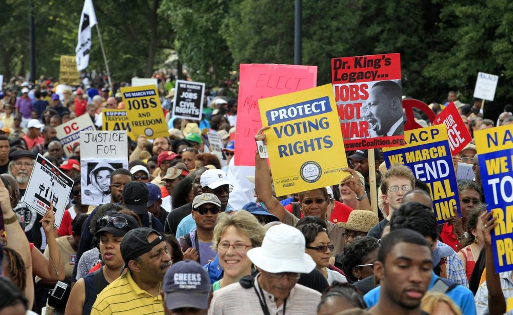 Demonstrators march towards the Martin Luther King Jr. Memorial during the 50th anniversary commemoration of the 1963 March on Washington Saturday, Aug. 24, 2013, in Washington. (Jose Luis Magana/AP)