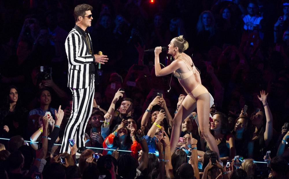 "Robin Thicke, left, and Miley Cyrus perform ""Blurred Lines"" at the MTV Video Music Awards on Sunday, Aug. 25, 2013, at the Barclays Center in Brooklyn, New York. (Charles Sykes/Invision via AP)"