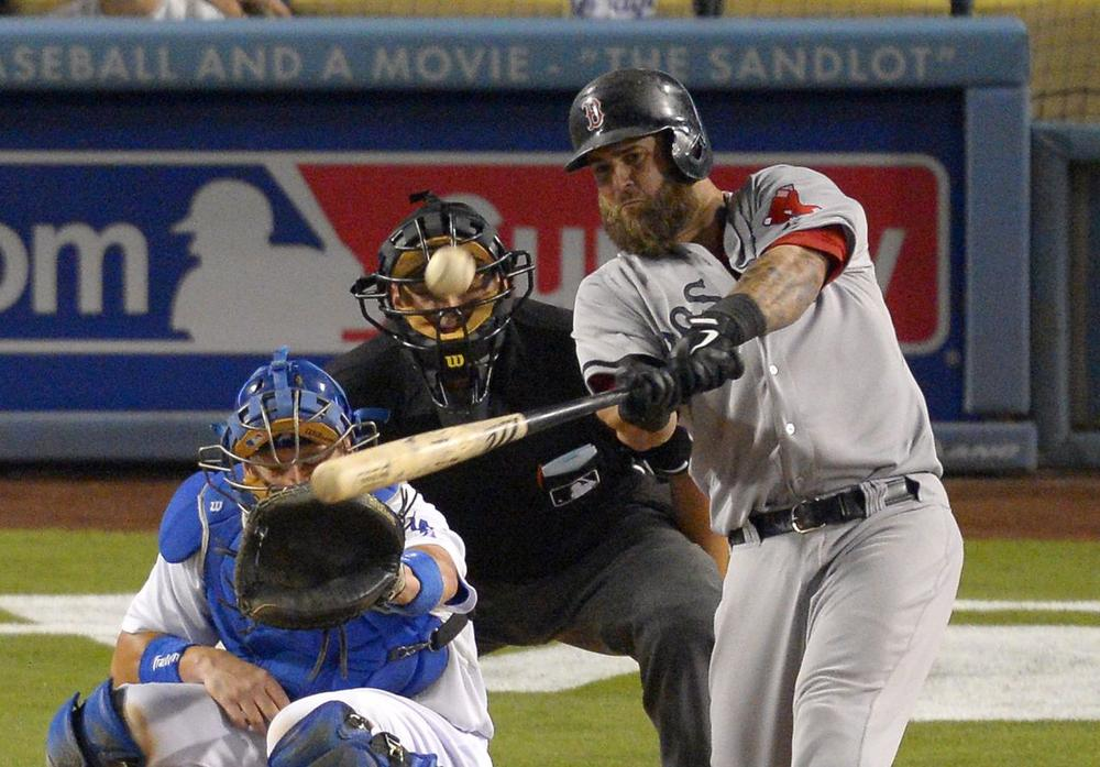 Boston Red Sox's Mike Napoli, right, hits a two-run home run as Los Angeles Dodgers catcher A.J. Ellis, left, and home plate umpire Brian Knight look on during the ninth inning. (AP/Mark J. Terrill)