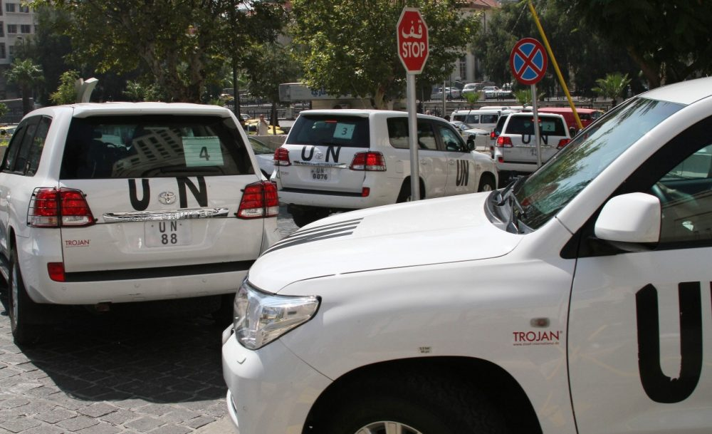 A U.N. team scheduled to investigate an alleged chemical attack leaves its hotel in a convoy, in Damascus, Syria, Monday, Aug. 26, 2013. (AP)