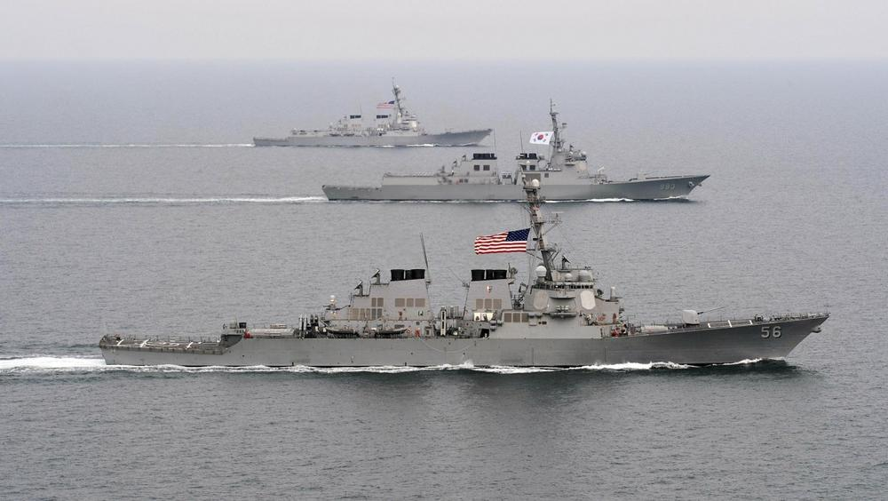 U.S. Navy destroyers are pictured during exercises in March 2013. (Specialist 3rd Class Declan Barnes/U.S. Navy via AP)