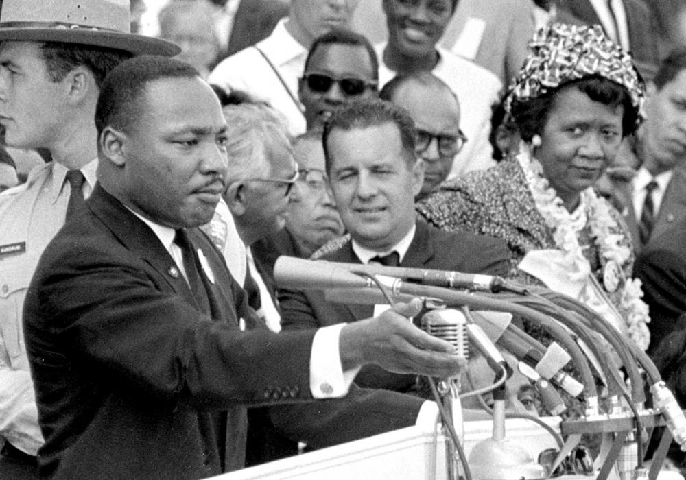 """Dorothy Height, right, National President of the National Council of Negro Women and Director of the center for Racial Justice of the national YWCA, listens as the Rev. Dr. Martin Luther King Jr., gestures during his """"I Have a Dream"""" speech, Aug. 28, 1963. (AP)"""