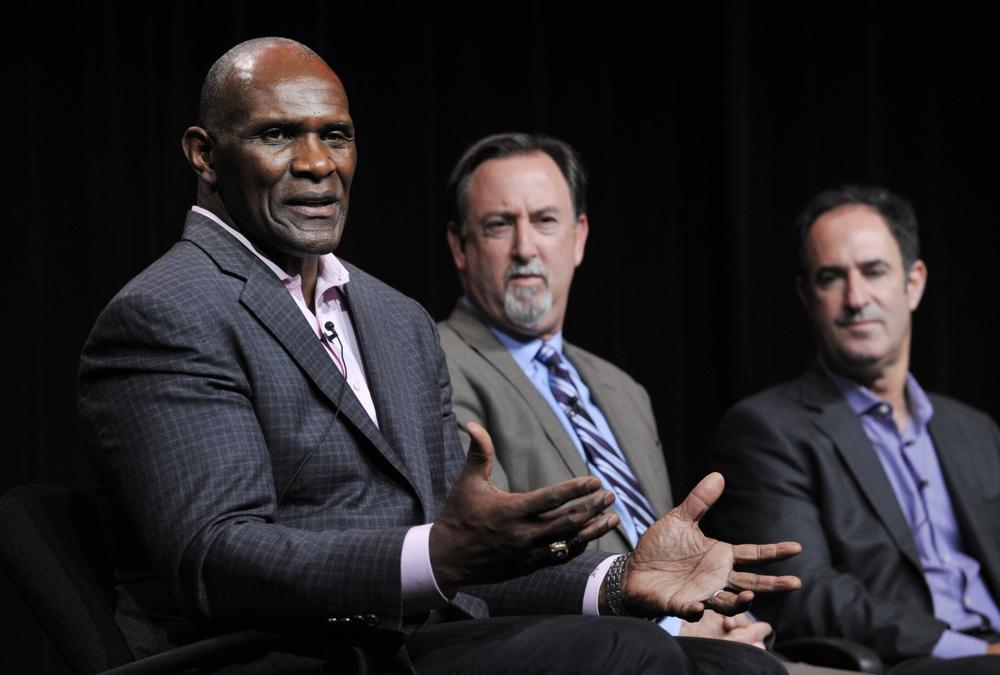 """Former New York Giants linebacker Harry Carson and ESPN investigative reporters Mark Fainaru-Wada and Steve Fainaru (l-r) took part in a panel discussion to promote the Frontline / ESPN documentary """"League of Denial"""" in early August, but now ESPN has pulled out of the project. (Chris Pizzello/Invision/AP)"""