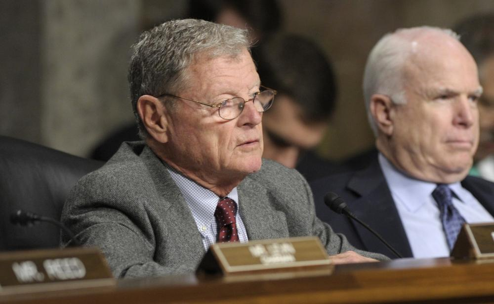 Senate Armed Services Committee member Sen. James Inhofe, R-Okla., left, is pictured in January 2013. At right is Sen. John McCain, R-Ariz., the ranking Republican on the committee. (Susan Walsh/AP)